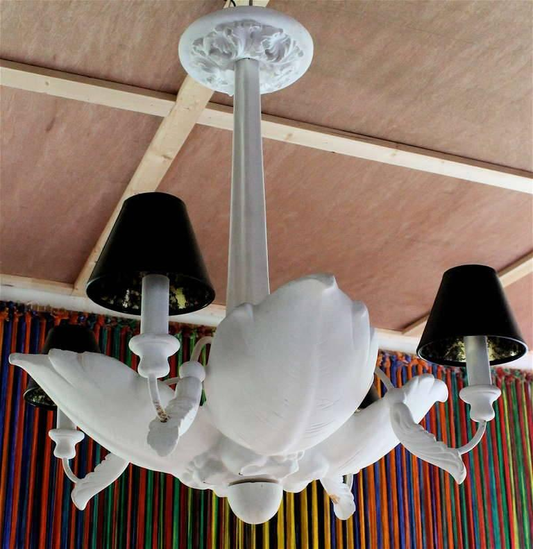 A large period chandelier, there are lights in each leaf and four lights under small shades. Needs to be rewired.