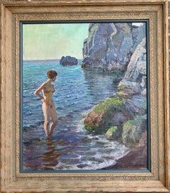 Nude Standing in Ocean, Rocks in Back