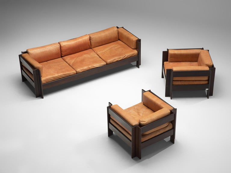 Sergio Asti for Poltronova, 'Zelda' living room set, leather and darkened wood, Italy, 1962.  Beautiful three seat sofa and two lounge chairs designed by Sergio Asti for Poltronova. The pieces of furniture are made with a dark wooden frame and