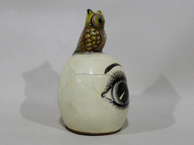 Sergio Bustamante Papier-mâché sculpture of owl sitting atop eyeball.