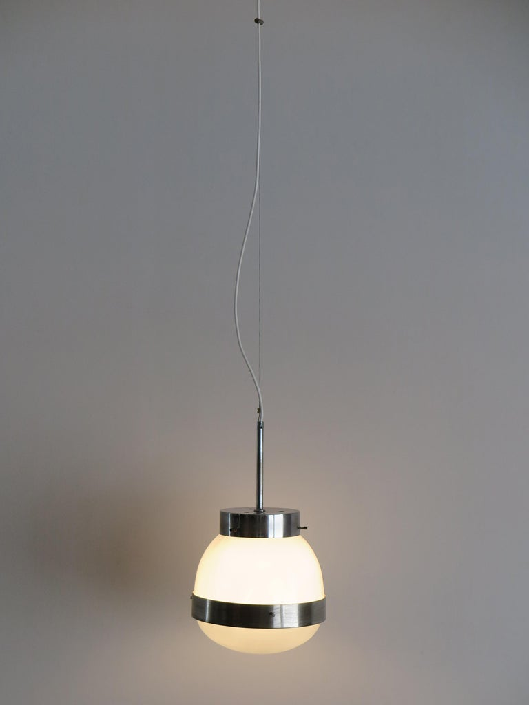 Italian Mid-Century Modern design pendant lamp model Delta designed by Sergio Mazza and produced by Artemide; chromed metal, opal glass and pressed glass, circa 1960s.  Please note that the lamp is original of the period and this shows normal