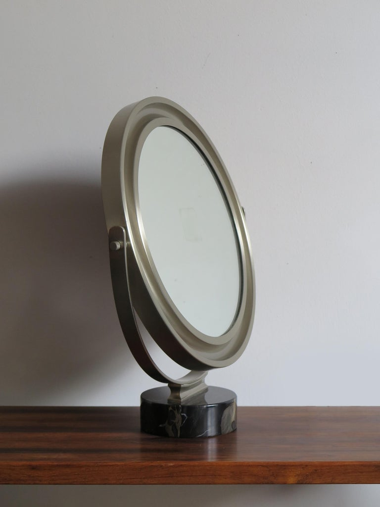 Italian Mid-Century Modern table mirror model Narciso designed by Sergio Mazza for Artemide with marble base, 1960s.