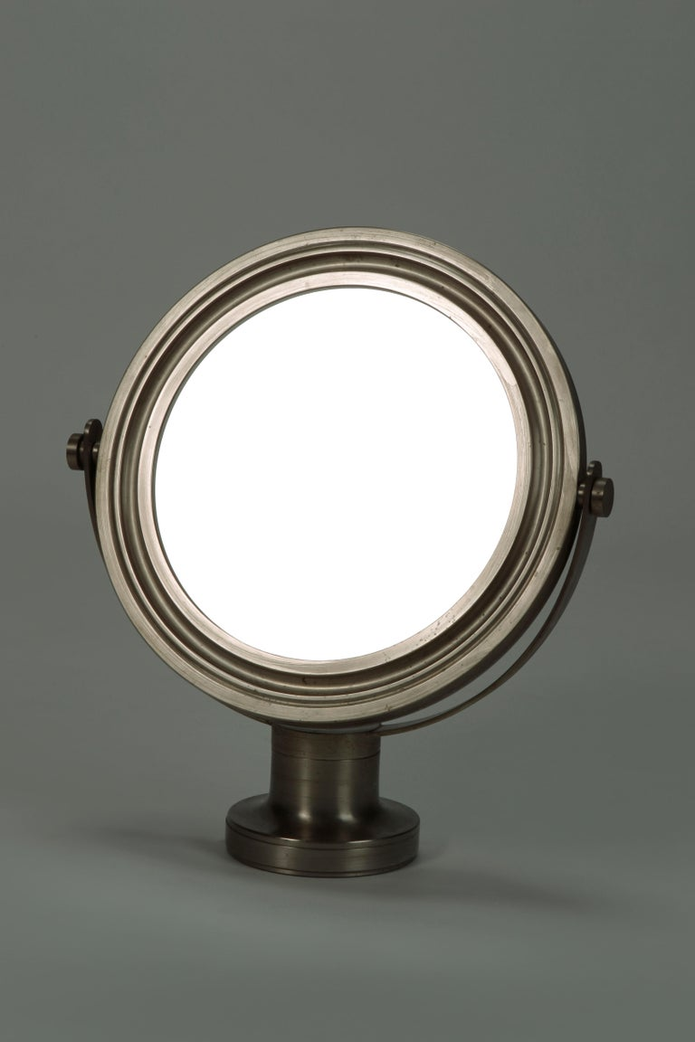 Narciso mirror by Sergio Mazza from the 60 years for Artemide Milano. With stable base and tiltable round mirror. Metal frame in original slightly opaque surface. Very good vintage condition.