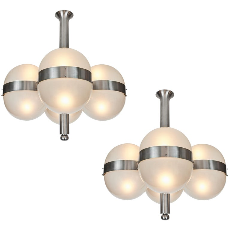 Sergio Mazza 'Tetraclio' chandeliers for Artemide, 1960s. Designed in 1961 and executed in nickeled brass and pressed opaline glass Professionally rewired for US electrical. Accommodates 8x standard e26 60W max bulbs.  Price is per item. Two lamps