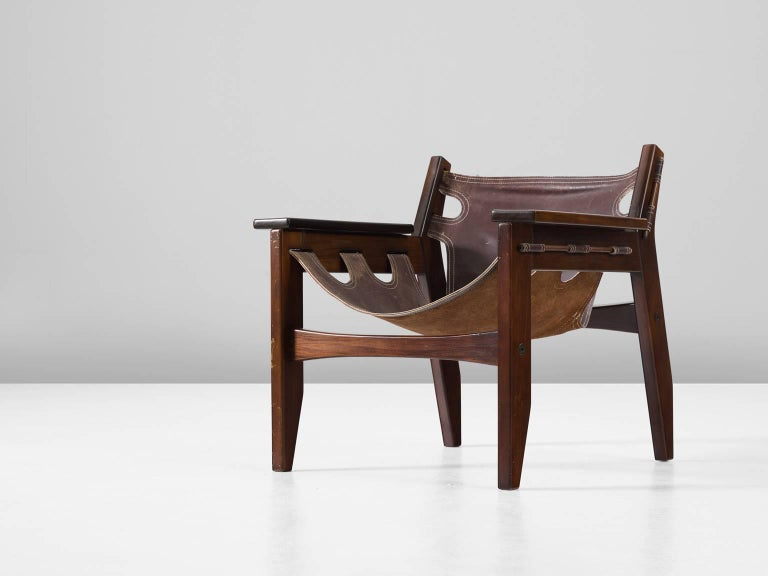 'Kilin' armchair, in rosewood and leather by Sergio Rodrigues for OCA, Brazil, 1973.  'Kilin' easy chair in Jacaranda rosewood and brown leather. This chair has a sturdy appearance and is designed with high attention to detail. The thick saddle