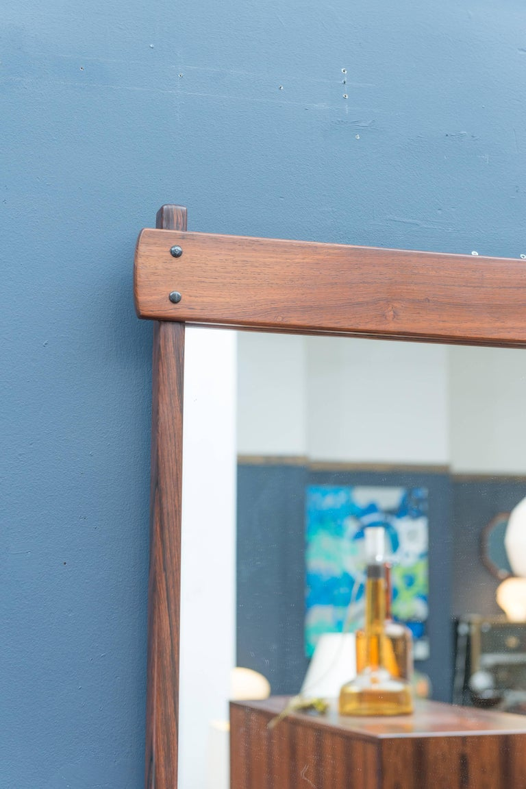 Sergio Rodrigues design wall mirror. Superb quality construction made from solid Brazilian rosewood in excellent condition.