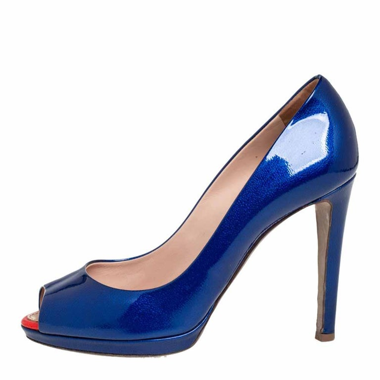Those stylish outfits will look a lot more appealing with these pumps from Sergio Rossi. They have been crafted from blue patent leather into a peep-toe silhouette and elevated on 10 cm heels. They are easy to slip on and come endowed with