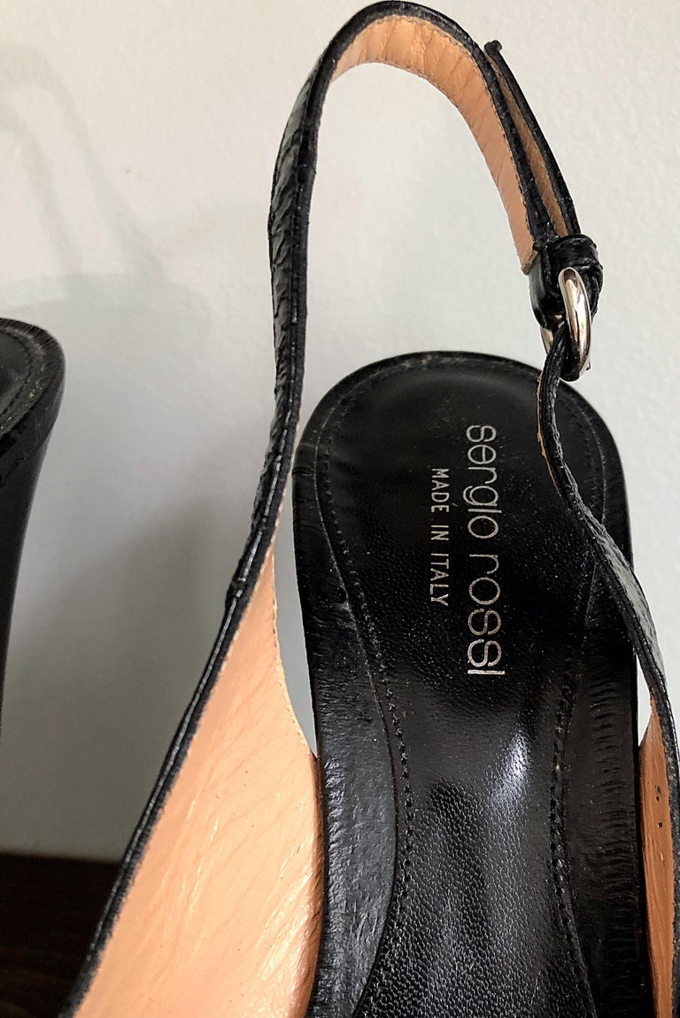 Beautiful SERGIO ROSSI black eel skin and leather platform high heels in Size 36 / US 6 ! Stacked platforms. Make these beauties easy and comfortable to wear all day. Slingback style with adjustable straps. Can easily be dressed up or down. Great