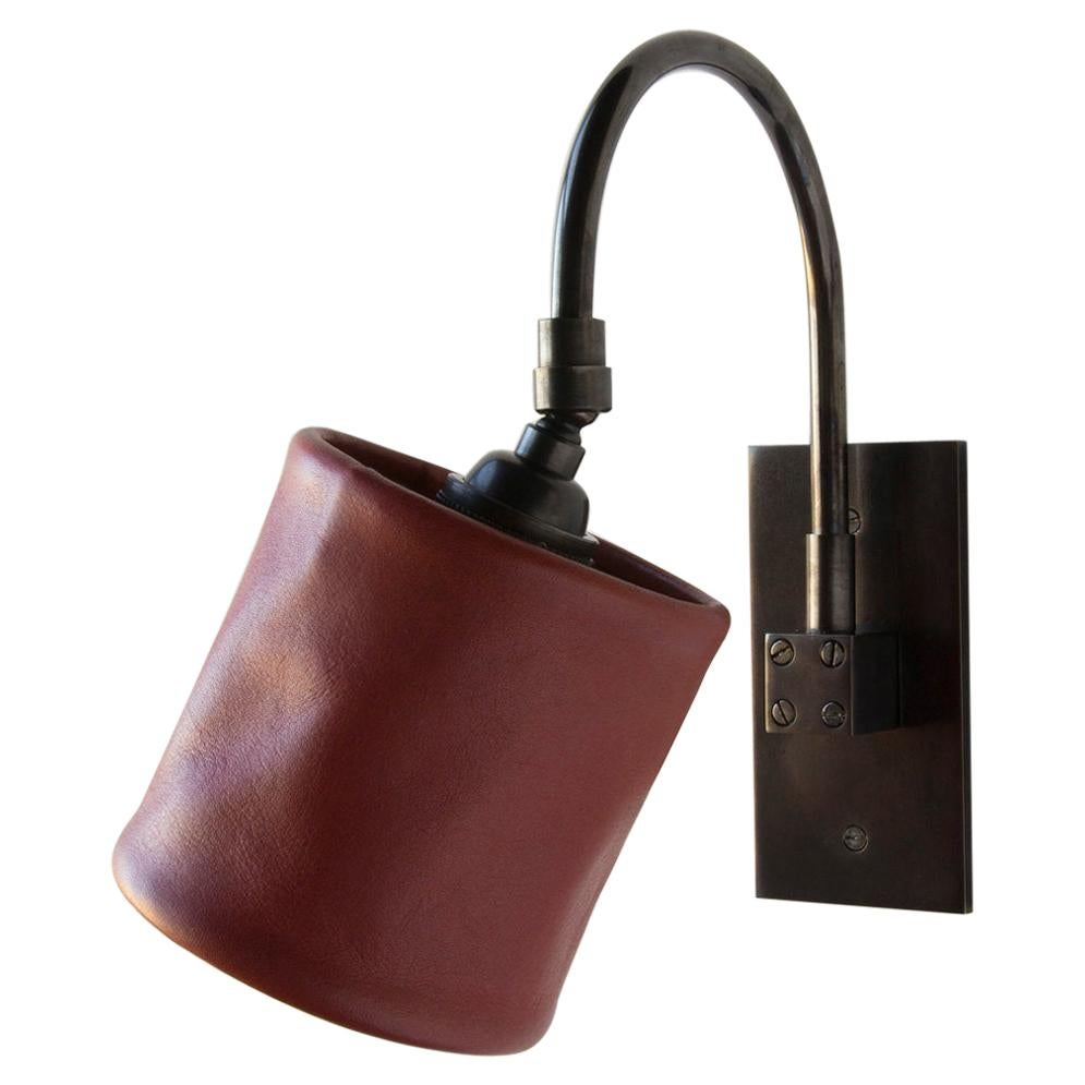 Series01 Small Sconce, Dark Patinated Brass, Gochu Red Leather Shade, Pivoting
