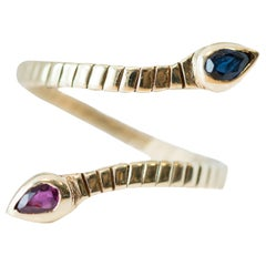 Serpent Gold Ring Featuring Ruby and Sapphire in 14 Karat Yellow Gold