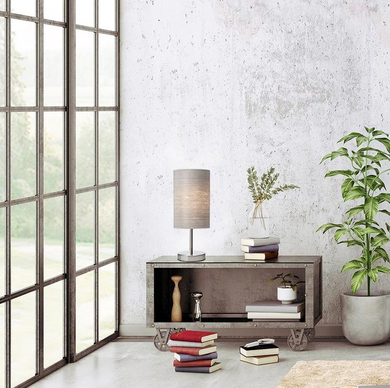 This gray tay maple wood SERRET is a small Mid-Century Modern table lamp used as a luxury light for bar or side table, alcove or bedside lighting. This modern lamp is customizable with a variety of contemporary wood veneer finishes and a light stand