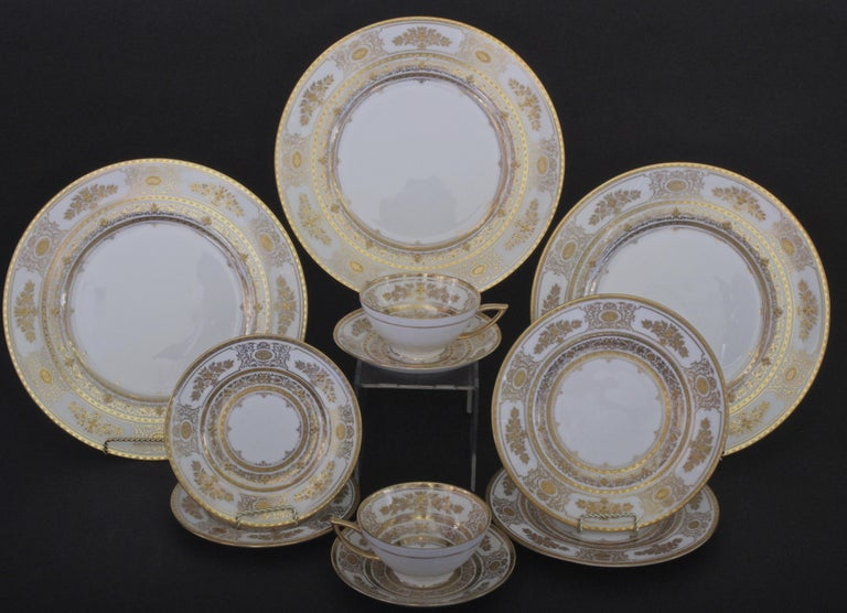 Here is a rare gilded service for 12 from Minton, Stoke-on Trent, England. This ornate and beautiful pattern is called Argyle. The set includes dinner, salad/dessert and bread plates, as well as teacups with saucers. One extra dinner plate is