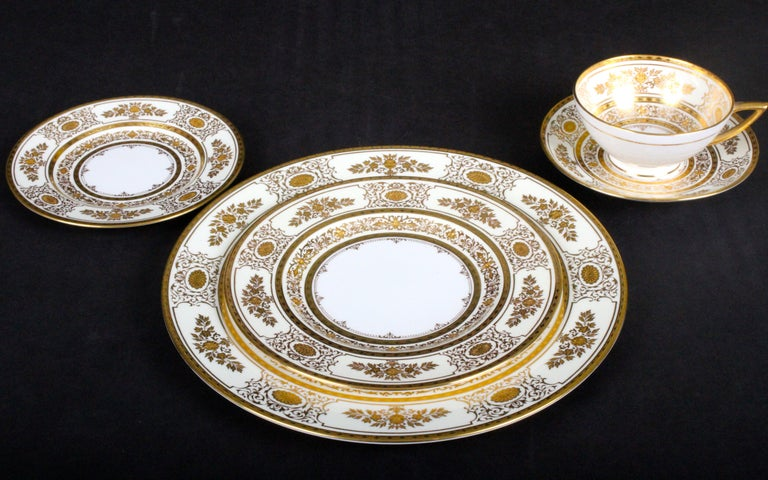 English Service for 12 of Minton for Tiffany Ivory Gilded Plates For Sale