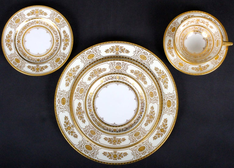 Burnished Service for 12 of Minton for Tiffany Ivory Gilded Plates For Sale