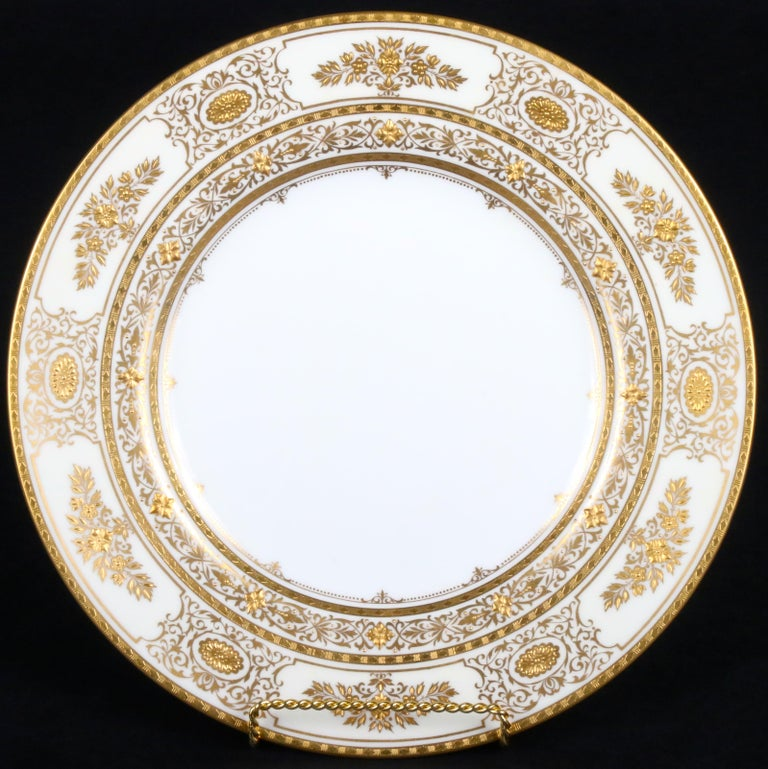 Service for 12 of Minton for Tiffany Ivory Gilded Plates In Excellent Condition For Sale In New York, NY