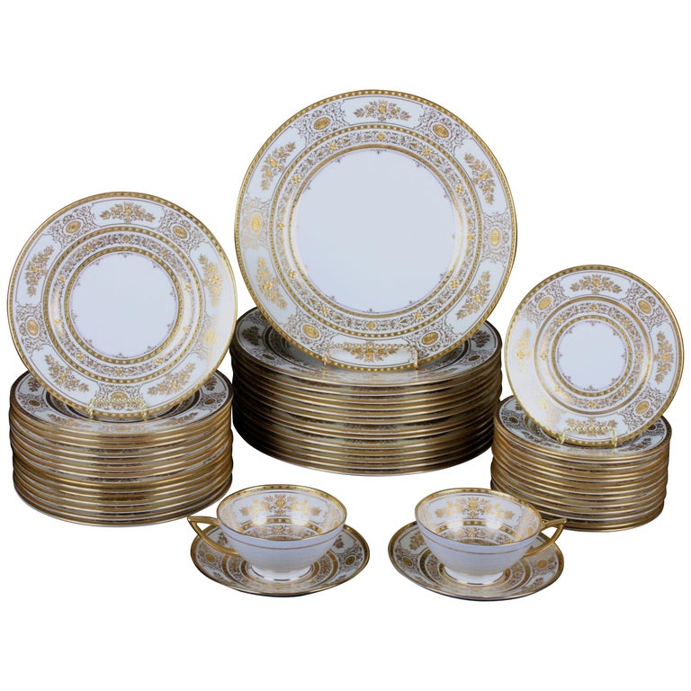 Service for 12 of Minton for Tiffany Ivory Gilded Plates For Sale