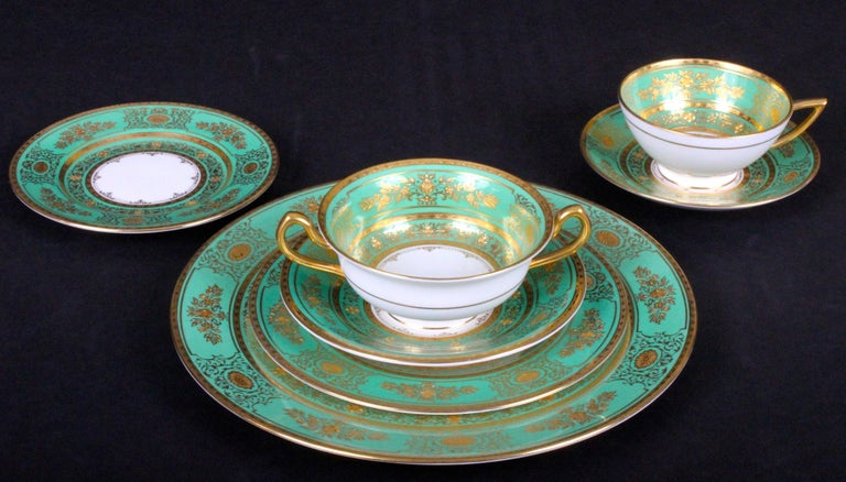 Here is a rarely available large gilded service for 18 in green from Minton, Stoke-on Trent, England. This ornate and beautiful pattern is called Argyle. The set includes dinner, salad or dessert and bread plates, soups bowls, cream soups and