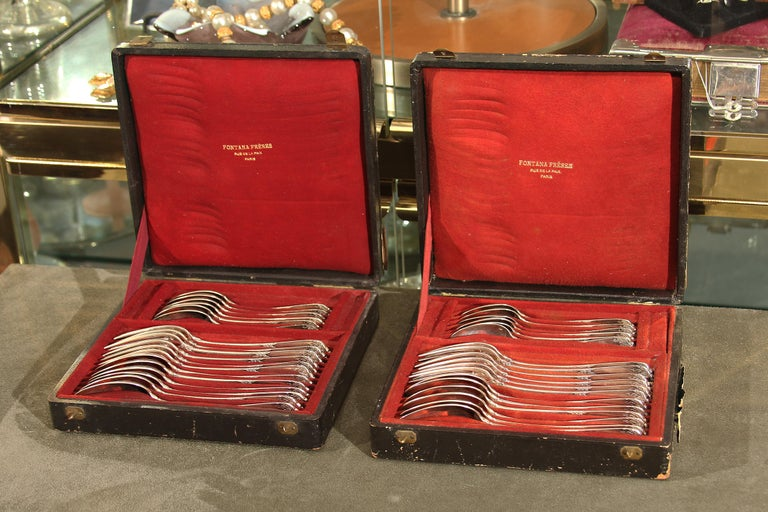 Heavy sterling flatware set for twelve made by French jeweler Fontana Fre'res, Rue de La Paix, Paris. Engraved MARIE on back handle of each piece. Each box contains 6 each soup spoons, teaspoons and forks. Both black boxes have metal carrying