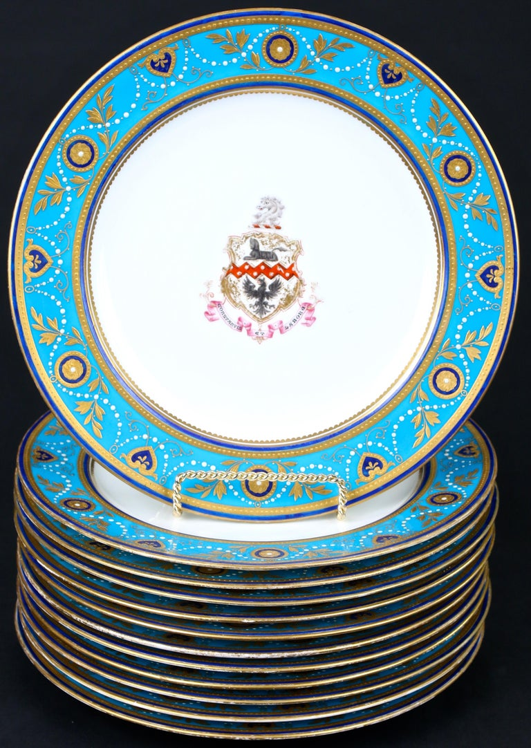Enameled Service of Minton Turquoise and Gold Encrusted Armorial Plates with Side Plates For Sale