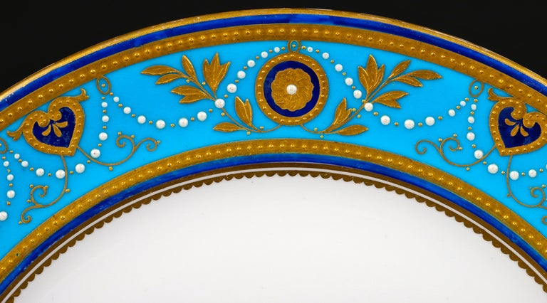 Porcelain Service of Minton Turquoise and Gold Encrusted Armorial Plates with Side Plates For Sale
