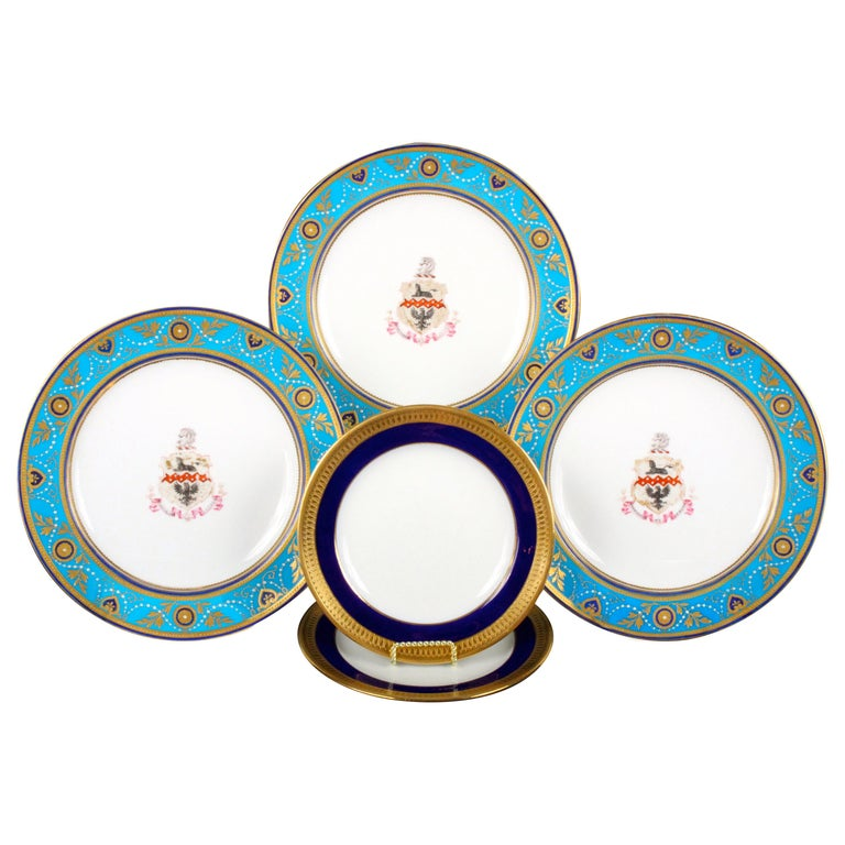 Service of Minton Turquoise and Gold Encrusted Armorial Plates with Side Plates For Sale