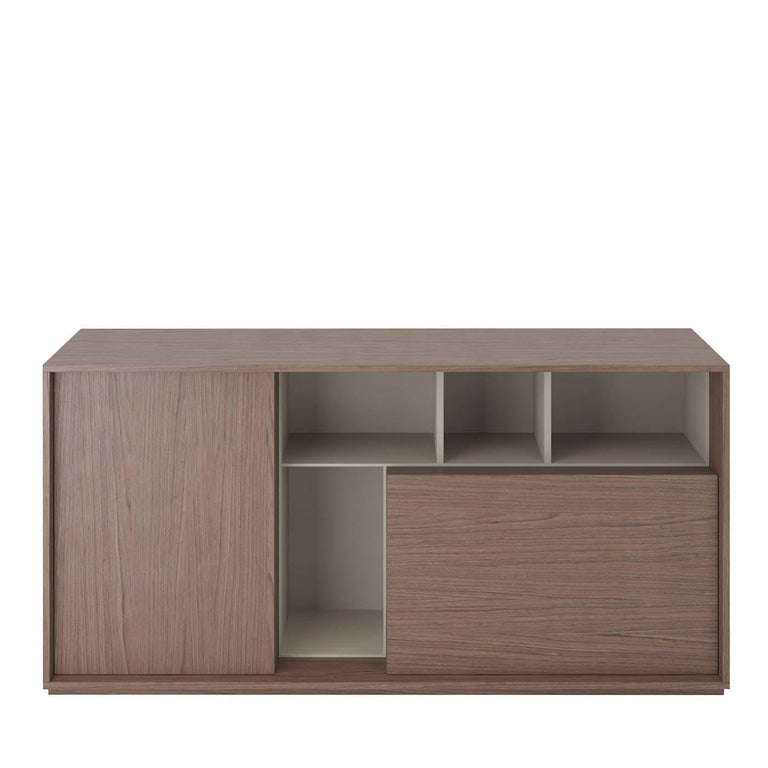 Combining open and closed compartments in a versatile and timeless design, this sideboard is a unique addition to the Sessanta collection. It is made of heat-treated, durmast veneered wood with inserts and internal structure in gray-finished