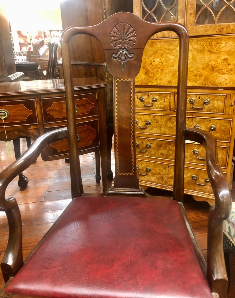 A very fine and unusual set of six (4 sides, 2 arms) antique English inlaid and hand carved solid mahogany Queen Anne style dining chairs with a lovely, comfortably curved, rectangular, flame mahogany back splat with checkered inlay. The crestrail