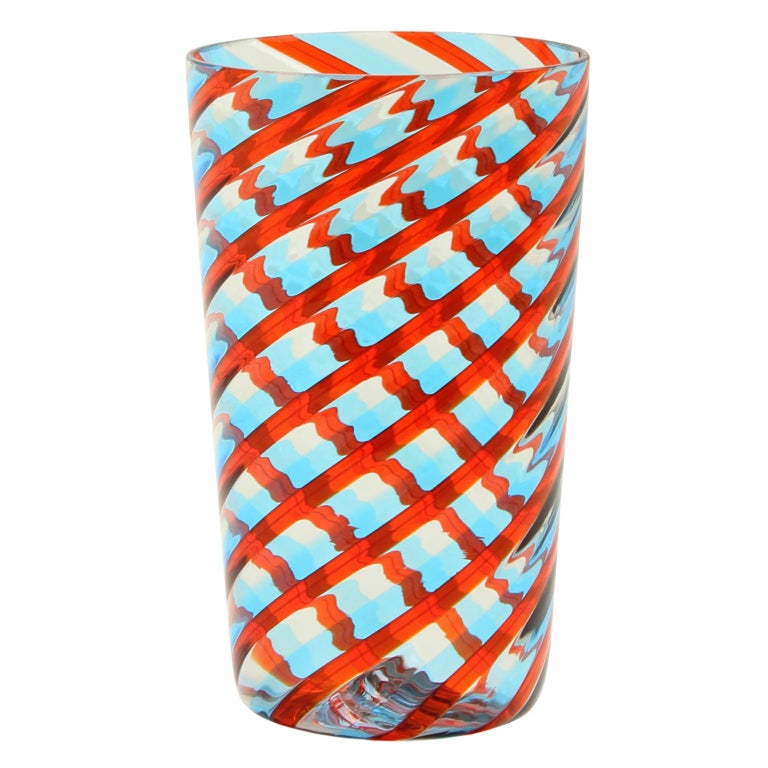 These artistic glasses are handmade by the master artisan with light blue, red, clear glass canes, spyral handcrafted.   Precious pieces that can enrich every table.  The product comes directly from our Murano glass factory in Italy custom