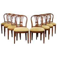 Set of 8 Carved Walnut Balloon Back Maison Jansen Louis XVI Dining Chairs