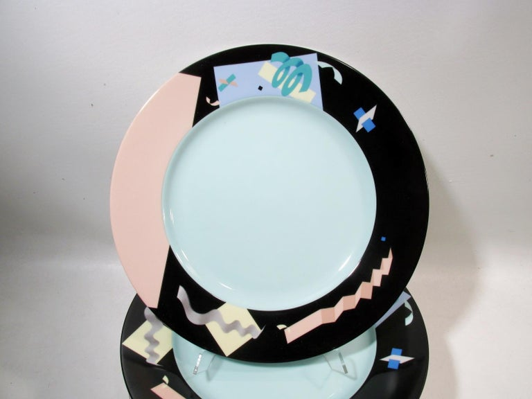 """Set of 8 - 12"""" diameter service plates or chargers. From a renowned 1980s series of architect and prominent designer commissioned tableware designs in fine porcelain from Swid Powell. Designed by Steven Holl, the pattern is the Memphis movement"""