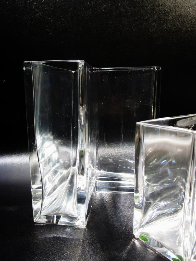 """Rarely seen pair of Baccarat fine crystal Angolari vases. Also called the angular vases, these were designed in 1978, came in several heights, by Roberto Sambonet. Heavy in the hand and made in France. Both are 5 7/8"""" along sides, shorter is 7.75"""""""