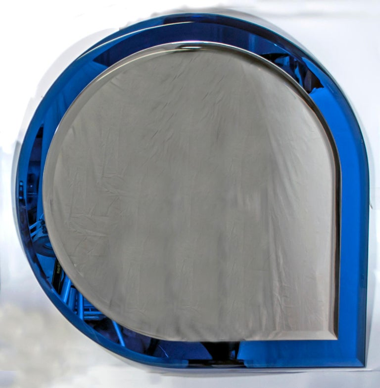 Bathroom set, complete with mirror and lighting, in blue and transparent glass, produced by Fontana Arte in the 1960s, The glass has a thickness of 10 mm The set consists of: - a mirror: 68 x 68 cm - two wall lights: 32 x 9 x 16 cm - a