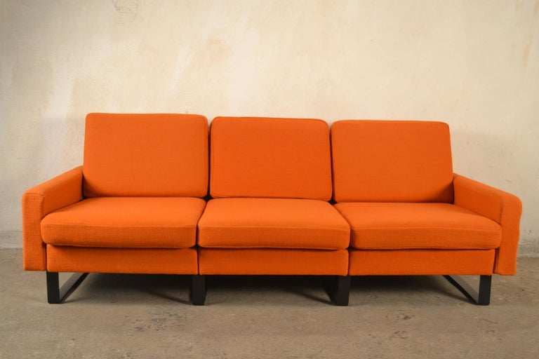 The sofa set and two armchairs designed by Friedrich Wilhelm Moller are from the 1960s. Manufactured by Cor. Fully original, without any renovation. The upholstery was made of thick, natural wool. There are slight wipes, fading. The width of the