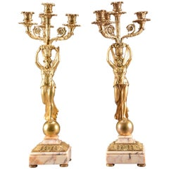 Set Empire style gilt bronze three light candelabra, figure of a winged Victory