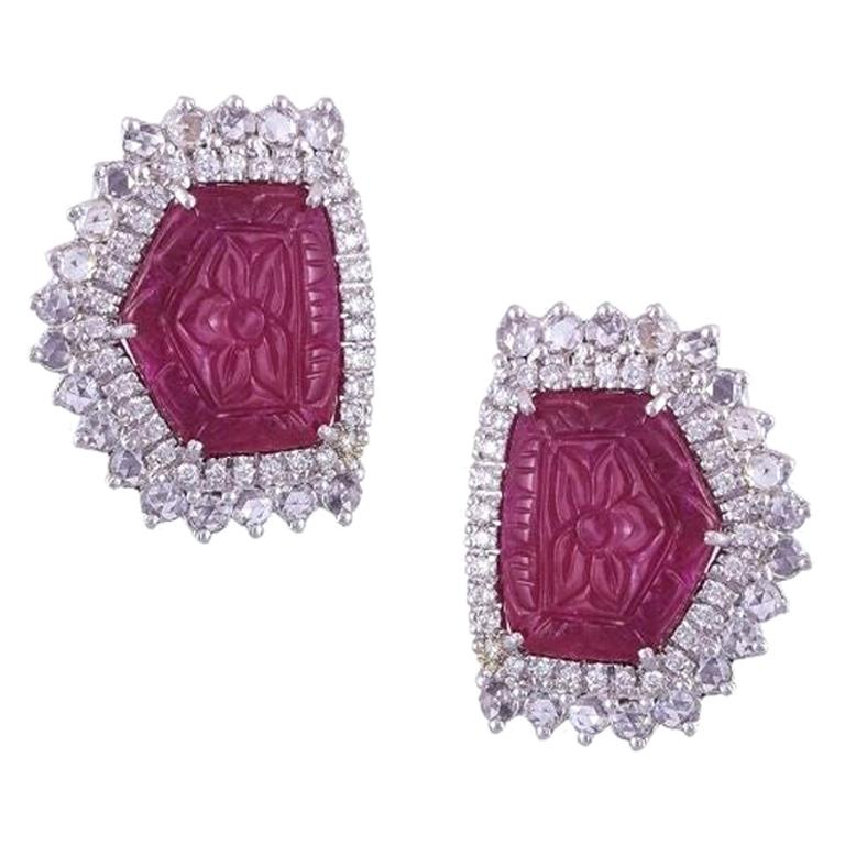 Set in 18 Karat Gold, Natural, Mozambique Carved Ruby and Diamonds Stud Earrings For Sale