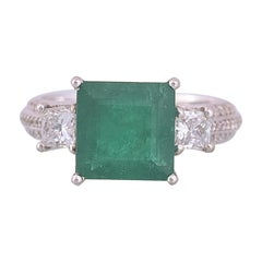 Set in 18 Karat Gold, Square Zambian Emerald and Princess Diamonds Ring