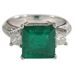 Set in 18 Karat Gold, Square Zambian Emerald and Princess Diamonds Ring