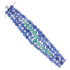 Set in 18K gold, Burmese Blue Sapphires and Russian Emeralds Flexible Bracelet