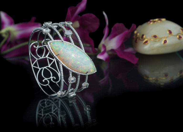A gorgeous and very chic Ethiopian Opal and Rose Cut Diamonds art - deco style Cuff bracelet. The Ethiopian Opal is natural and weighs 33.37 carats. The weight of the rose cut diamonds is 3.36 carats. The bracelet is a cuff, hence fixed size. The