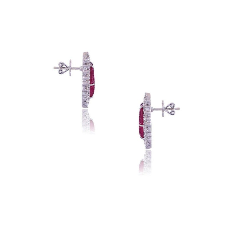 A very gorgeous pair of Ruby and Diamonds Stud Earrings set in 18K White Gold. The weight of the Ruby is 16.10 carats. The Ruby has originated from Mozambique and is completely natural without any treatment. The carving is hand-carved and done in