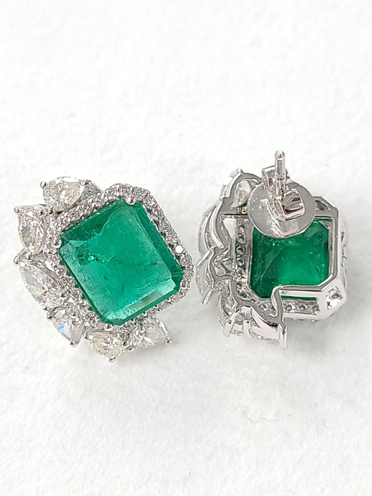A pair of gorgeous emerald studs with a modern and chic design. these natural zambian emerald weight around 6.49 carat combined with diamond weight of 2.78 cts . these studs are perfect to wear for a elegant and modern look for a formal and semi