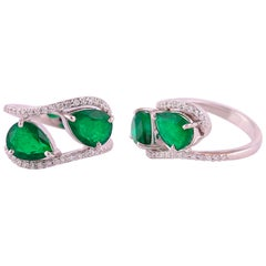 Set in 18K White Gold, Pear Shaped Zambian Emerald and Diamond Two-Stone Ring