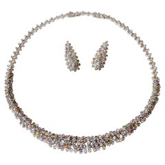 Set in White Gold and 260 Multicolored Sapphires Necklace and Earrings