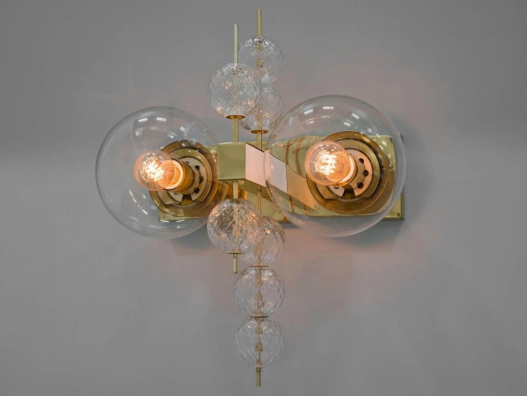 Large set of 16 hotel wall chandeliers with brass fixture and large hand blown glass. The scones are beautifully decorated thanks to the structured glass. The pleasant light it spreads is very atmospheric, these wall chandeliers will contribute to a