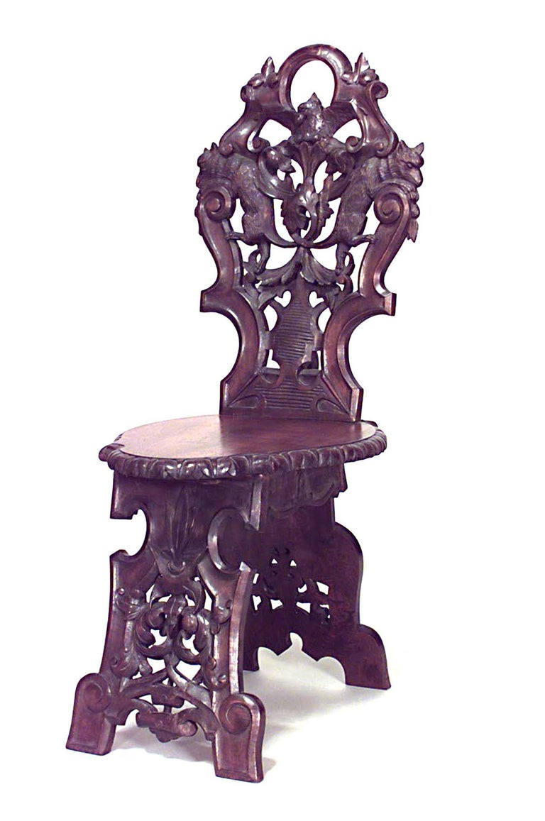 Set of 10 Rustic Black Forest (19th Cent) walnut side chairs with shaped seat and back with filigree carving and animals.