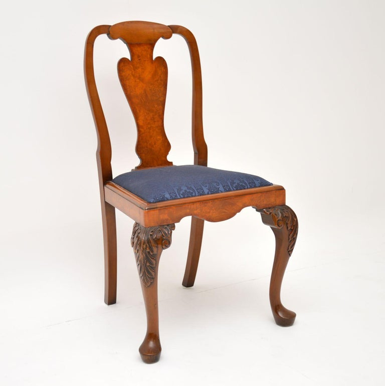 A beautifully made set of 10 antique Queen Anne style dining chairs, these date from circa 1930s-1950s. They are of super quality, made from solid walnut with lovely burr walnut veneers on the back and seat edges. They are in great original
