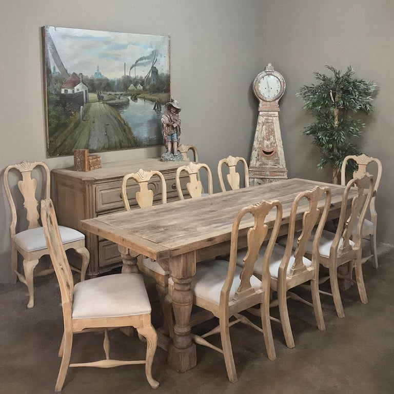 Set of 10 Antique Swedish Stripped Dining Chairs have been newly upholstered in a lovely neutral grey fabric that is so in vogue right now! The stripped finish on the chairs makes them ideal for todays decor of elegant dining room!  Lovely details