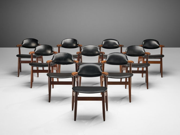 Set of 10 dining chairs, faux leather, teak, the Netherlands, 1960s  Scandinavian Modern 'bullhorn' armchairs with teak frames. The short armrests remind of a 'bullhorn', hence the nickname. Produced in the Netherlands in the 1960s, these chairs