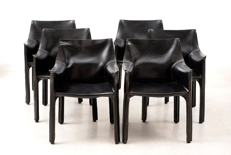 Gorgeous matching set of 10 cab chairs in black leather by Mario Bellini for Cassina. Six armchairs and 4 side chairs. Italy, 1970s.