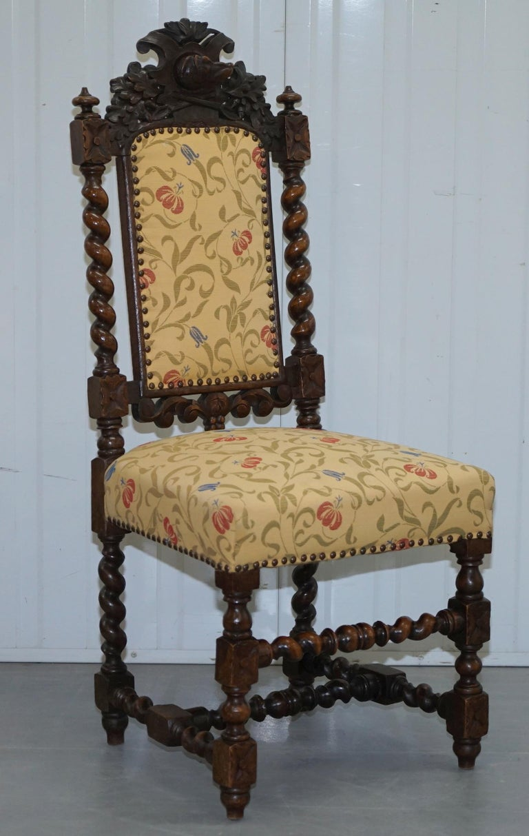 English Set of 10, circa 1800 Oak Jacobean Style Dining Chairs with Dog Head Cresting For Sale